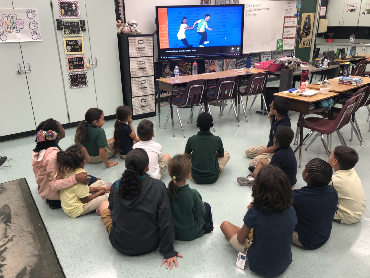 third graders and kindergarten students buddy up to understand flocabulary lyrics and learn vocabulary as part of small group instruction