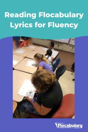Students chorally reading flocabulary lyrics aloud together as a fluency strategy