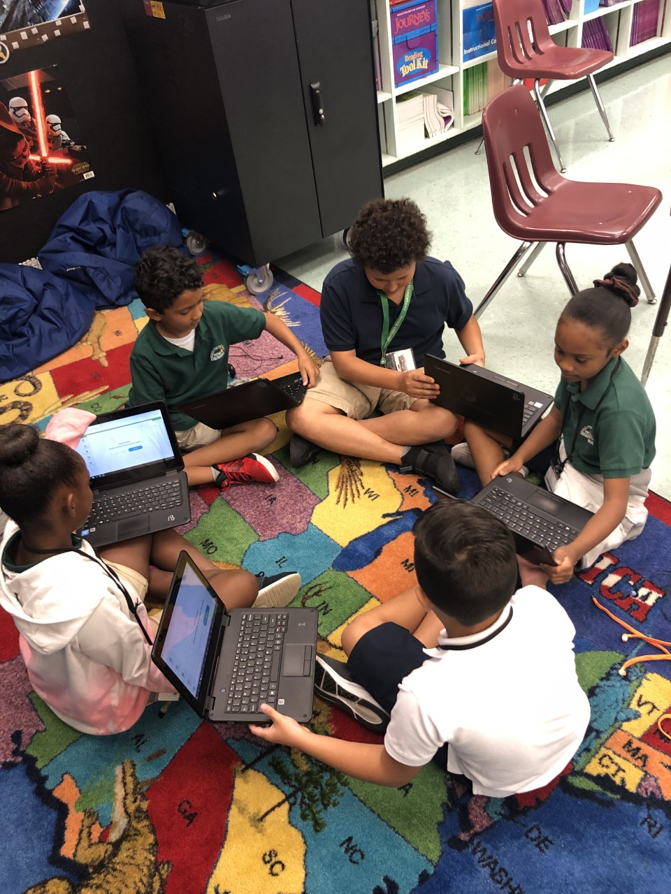 students work together and collaborate to play a vocabulary game as part of flocabulary small group instruction